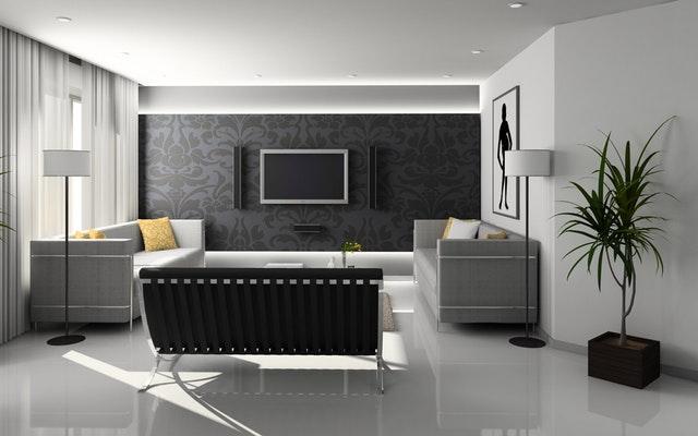 Obývacia izba ladená do čiernych a bielych farieb s veľkými presklennými dverami